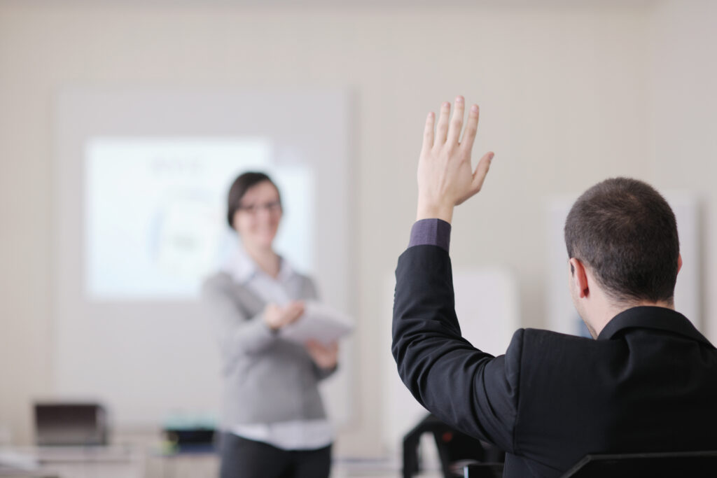 Woman giving a presentation and answering questions